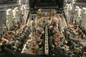 Troops load up inside the belly of a C-17. Photo: Zachariah Hughes/KSKA.