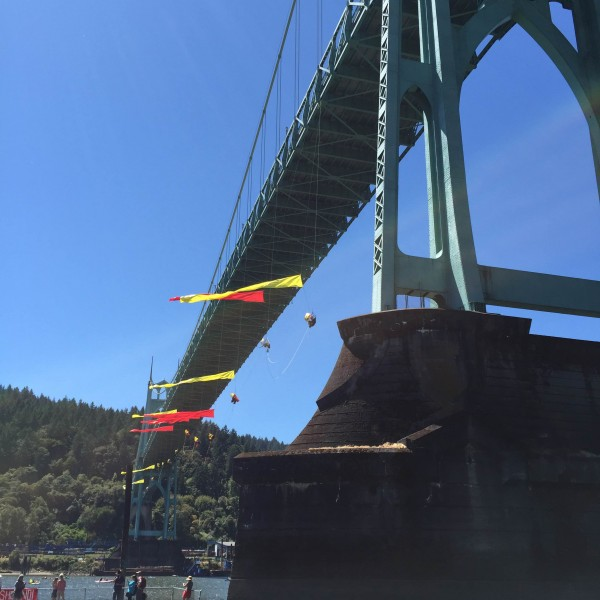 Thirteen Greenpeace protesters are suspended from the St. John's Bridge over the Willamette River in an attempt to impede Shell's icebreaker vessel from returning north. Photo: Liz Arnold, shared with permission.