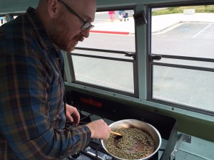 Austin Schwartz roasts coffee in the back of his vintage bus. Hillman/KSKA