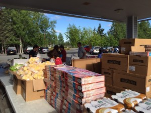 Volunteers help set up for the food pantry at Muldoon Community Assembly Church in Anchorage. Hillman/KSKA