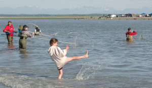 Harmony Goings, of Anchorage, entertains herself at the north beach of the Kenai River on Monday, while her family took to the water in the dip-net fishery.