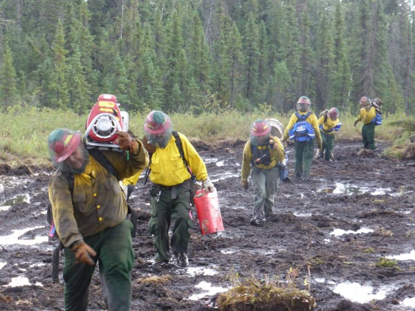 Mud and mosquitos! Rain made for a messy commute as firefighters headed to the fireline on the Spicer Creek Fire northeast of Tanana. The fire is one of five large fires burning near Tanana. AFS Photo.