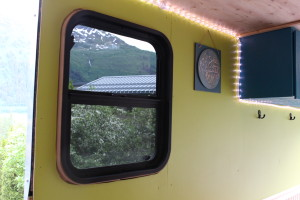 Window installation wasn't easy in the 98-square-foot trailer. (Photo by Elizabeth Jenkins/KTOO)