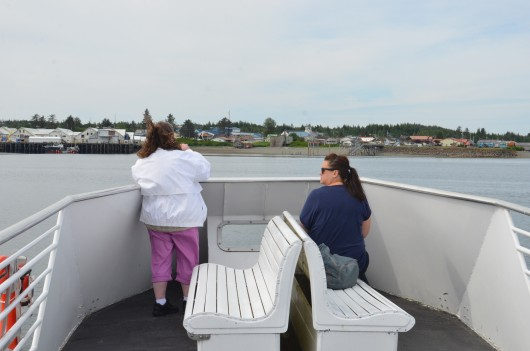 Tourists take pictures aboard an Allen Marine tour approaching Metlakatla on July 1, 2015. Photo by Ruth Eddy/KRBD.
