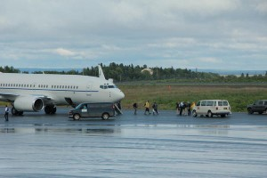 About a dozen people loaded off a jet bearing an American flag at the Dillingham airport Thursday evening. Credit Hannah Colton/KDLG