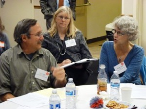 Guy Archibald of the Southeast Alaska Conservation Council, left, discusses issues with Sitka Mayor Mim McConnell, right, during Thursday's transboundary mine meeting in Juneau. (Photo by Ed Schoenfeld/CoastAlaska News)