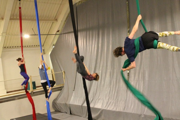 Some students come to circus with prior training in dance, yoga, or climbing. But many are new to the aerial arts. (Emily Kwong/KCAW photo)
