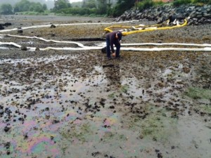 Fire Chief Dave Miller on Eagle Beach at 7 a.m. on Monday, August 17. Diesel from the Jarvis Street Power Plant spilled onto the beach from the storm water drainage system. (Photo courtesy of Mark Gorman, City of Sitka)