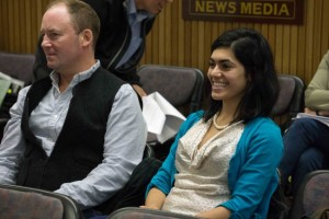 Israa Kako-Gehring beams after the Assembly adopts an ordinance relaxing land-use restrictions on childcare homes and centers, Aug. 10, 2015. (Photo by Jeremy Hsieh/KTOO)