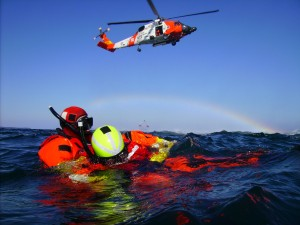 Rescue swimmers from Coast Guard Air Station Kodiak wait for a basket pickup by an MH-60 Jayhawk helicopter during open water training off the coast of Kodiak Island April 23, 2008. (Official USCG photo by PA1 Kurt Fredrickson)