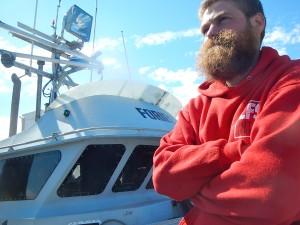 Mihey Basargin of Wasilla on the docks in Dutch Harbor after being rescued. (Photo by John Ryan, KUCB - Unalaska)
