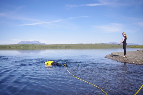 Soldotna High freshman Drew Wassily snorkels in Pungokepuk Lake while Dillingham senior Savanna Sage casts with a spinning rod on August 5, 2015. Fish were a highlight of the four-day float from the lake to the Togiak River.