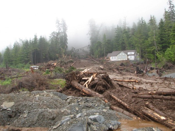 A new home under construction on Sitka's Kramer Avenue was obliterated in the slide. A neighboring home is unscathed. (Photo by Joel Curtis/National Weather Service)
