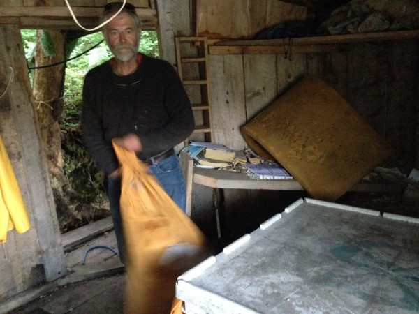 Sorting mail in the fish tote. Photo: Shady Grove Oliver/KBBI
