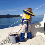 Tips for sailing with tots? Throwing rocks overboard is boatloads of fun. Photo courtesy of the Bradleys.