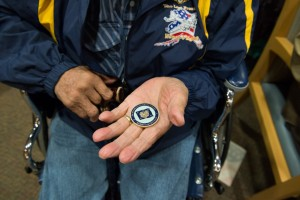 At the listening session in Kotzebue, McDonald gave veterans a coin with his seal and signature. Photo: Mitch Borden, KNOM