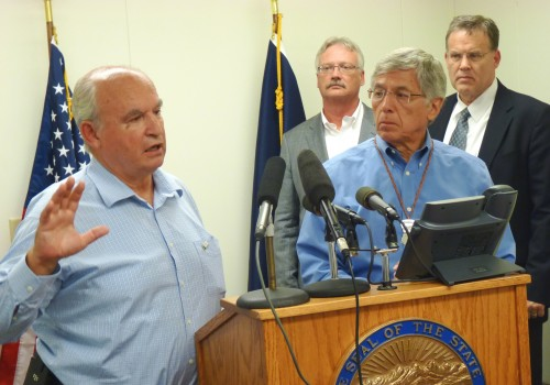 B.C. Mines Minister Bill Bennett discusses the week's mine meetings as Lt. Gov. Byron Mallott and other state officials listen during a Wednesday press conference in Juneau. (Photo by Ed Schoenfeld/CoastAlaska News).