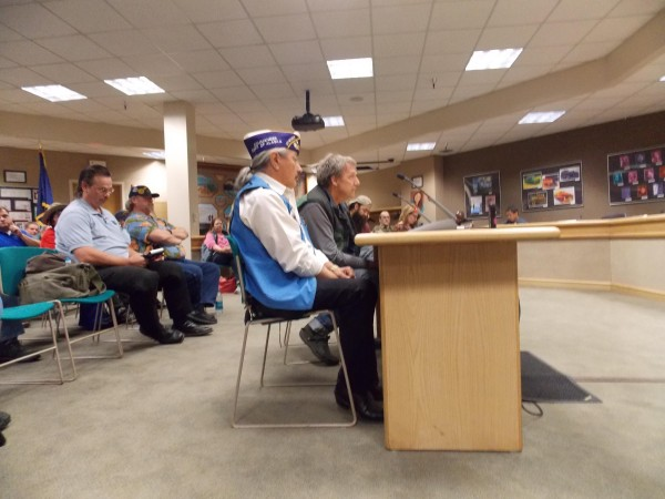 Alaska Native Veteran's Association President Benno Cleveland (foreground) speaks at VA listening session. Credit Dan Bross / KUAC