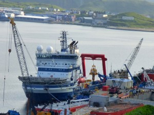 The Fennica and its yellow capping stack in Alaska's Dutch Harbor on July 18. (KUCB/John Ryan photo)