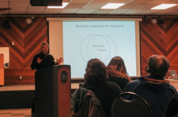 Greg Finstad presents on the social and economic impact of reindeer herding at the U.S. Arctic Research Commission's meeting in Nome. Finstad works with the reindeer research program at the University of Alaska Fairbanks. Photo: Laura Kraegel, KNOM.