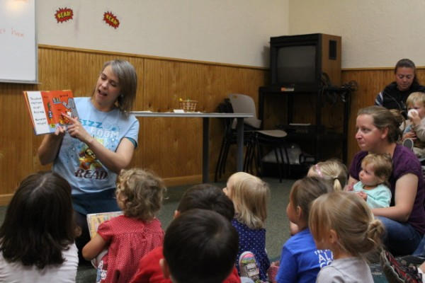 Amelia Jenkins reads a book for the last storytime at the Mendenhall Mall library location. (Photo by Elizabeth Jenkins/KTOO)