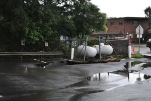 A sinkhole had opened up beneath a pair of propane tanks on Halibut Point Road. (Rebecca LaGuire, KCAW)