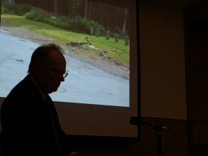 Jay Smith stands before a photo of Jeff Dusenbury's bike as it lay where he was hit and killed. Hillman/KSKA