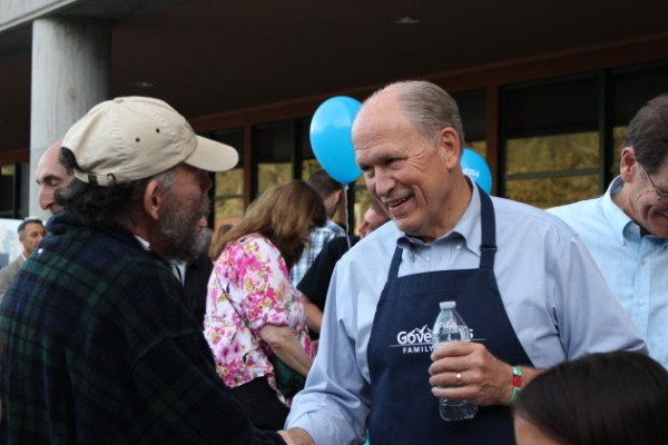 Walker greets people at his first Juneau Governor's Picnic. (Photo by Elizabeth Jenkins/KTOO)