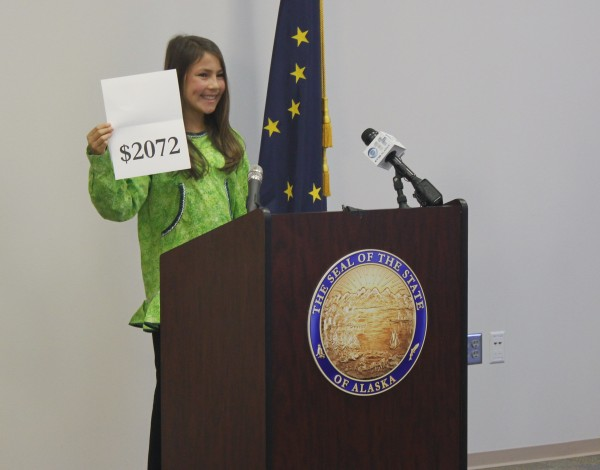 Palmer Jr. Middle School 7th grader, Shania Sommer, 12, announced the amount of the 2015 Permanent Fund Dividend. (Photo by Josh Edge, APRN - Anchorage)