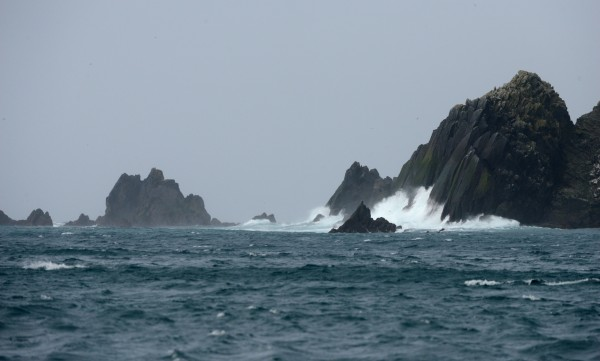 Waves break against rocks near Buldir Island as researchers and supplies are ferried from the US Fish and Wildlife Service research boat R/V Tiglax to Buldir Island in the Aleutians during a trip from Adak Island to Attu Island on a weeklong research mission in southwestern Alaska, on Tuesday, June 2, 2015. Scientists on the R/V Tiglax conduct research in the Alaska Maritime National Wildlife Refuge. (Bob Hallinen / Alaska Dispatch News)