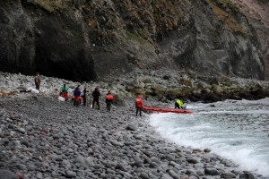 Researchers and their supplies are moved from a beach to the beach in front of their camp on Buldir Island as the US Fish and Wildlife Service research boat R/V Tiglax is on a weeklong voyage in the Aleutian Islands on Friday, June 5, 2015. The researchers and their supplies were dropped off earlier in the week and they hauled some the there supplies to the camp across the rocky beach. When seas moderated the Tiglax returned to transfer the rest of their supplies. 5 people were dropped off on the island including to research biologists from Memorial University of Newfoundland. Scientists on the R/V Tiglax conduct research in the Alaska Maritime National Wildlife Refuge. (Bob Hallinen / Alaska Dispatch News)
