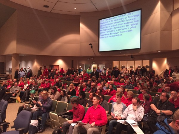 Mobilized by a coalition of faith groups, opponents of the measure wore red.