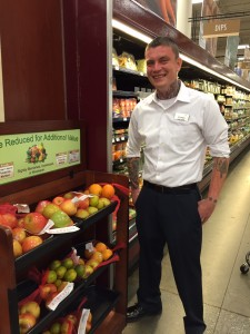 Stephen Longnecker stands beside the reduced price produce stand in Fred Meyer in Anchorage. (Hillman/KSKA)