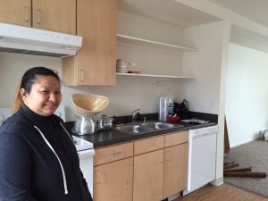Mae Lee in her new apartment at Susitna Square. (Hillman/KSKA)