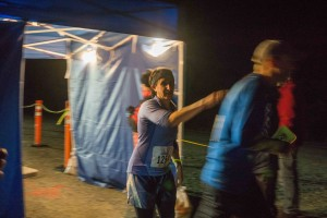 Sarah Bronstein hands off the relay fob at the end of leg four to Corey McKrill. (Photo by Jeremy Hsieh/KTOO)