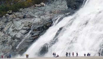 Visitors walk a trail around Mendenhall Lake to view Nugget Falls. Glacial floods closed that trail for part of this season. (Photo by Ed Schoenfeld/CoastAlaska News)