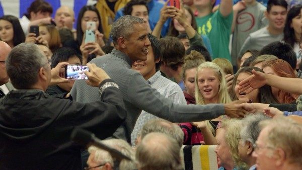 Obama greets gradeschool-aged children at the Dillingham School. Photo: Tara Young