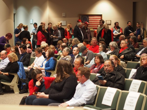 Members of the public line up to testify before the Anchorage Assembly on an anti-discrimination ordinance. Public testimony will continue Wednesday night, Sept. 16. Photo: Zachariah Hughes/KSKA.