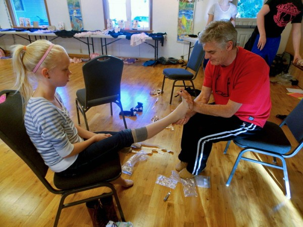 Philip Broadbent measures first time pointe shoe customer, Lydia Martin's, feet. (Joe Sykes)