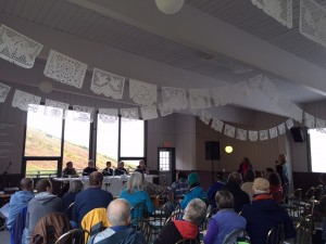 An interfaith panel on climate change spoke Saturday at Alpenglow Lodge in Arctic Valley. (Hillman/KSKA)