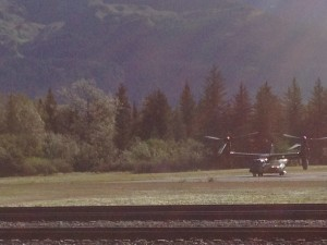 Choppers dance with the landing area ahead of the president's arrival. Photo: Ellen Lockyer/KSKA.
