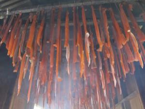 Silver salmon strips hang in Davidson's smokehouse. Photo Credit: Annie Feidt