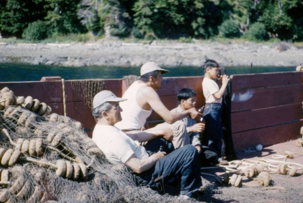 William L. Paul Sr. (left) with Walter Soboleff, M. Quinto and Ray Peck on a boat. (Photo courtesy of Sealaska Heritage Institute)