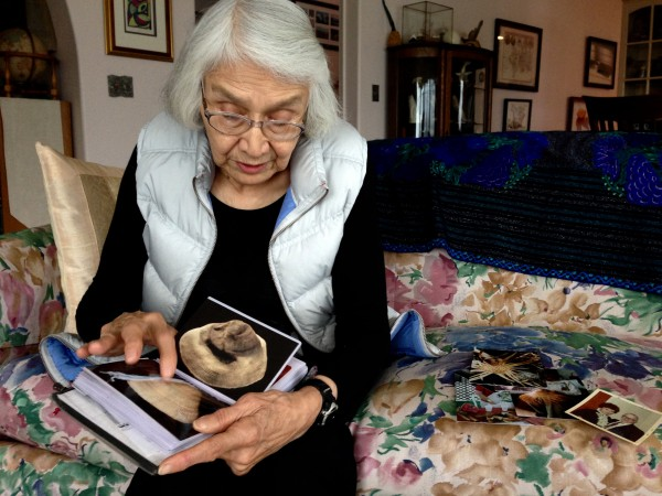 Delores Churchill shows a photo album of her weaving during a recent visit to Petersburg. Photo/Angela Denning