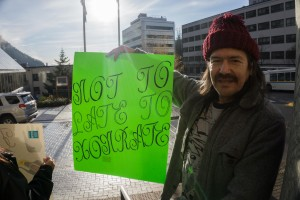 Franklin Harvey James Jr. shows off his protest sign in support of the Fairbanks Four, Oct. 24, 2015. (Photo by Jeremy Hsieh/KTOO)