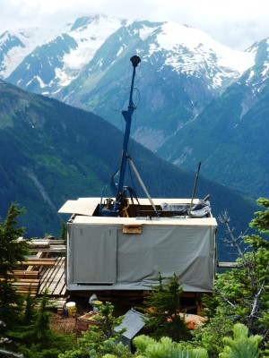 A KSM drill rig perches above a deep valley about 80 miles east of Wrangell. (Photo by Ed Schoenfeld/CoastAlaska News)