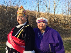 Ashley Doctolero and her mother Ada Coyle pose in their traditional regalia. Doctolero sewed her own clothes. (Hillman/KSKA)