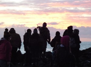 Students and mentors look for sea lions at sunrise on St. Paul Island, Alaska. Justine Kibbe photo.