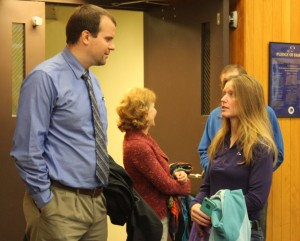 Nick Polasky talks with his client Kathleen Turley before trial Monday morning. (Photo by Lisa Phu/KTOO)