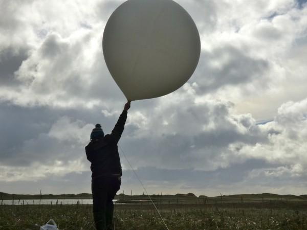 William Wells, about to launch a weather balloon on St. Paul Island, Alaska. (KUCB/John Ryan photo)